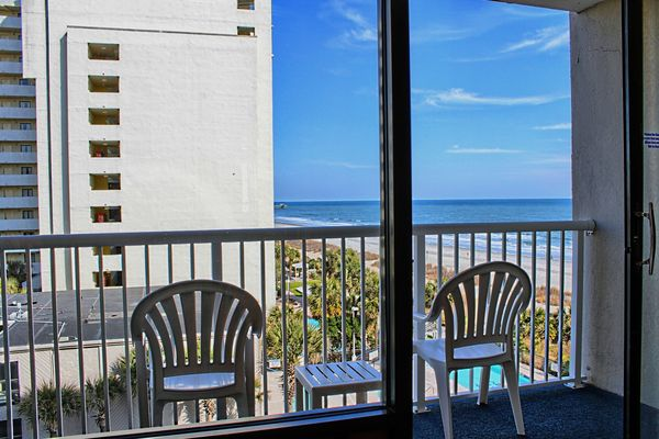 Myrtle Beach accommodations with ocean view and king bed at Captain's Quarters Resort